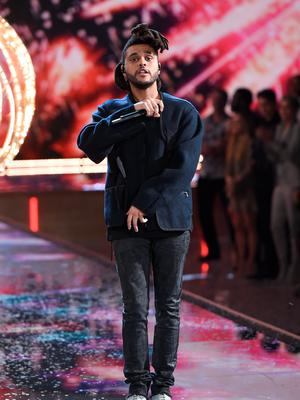 The Weeknd performs during the 2015 Victoria's Secret Fashion Show at the Lexington Armory on Tuesday, Nov. 10, 2015, in New York. The Victorias Secret Fashion Show will air on CBS on Tuesday, December 8th at 10pm EST. (Photo by Evan Agostini/Invision/AP)