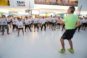 Press Eye - Belfast -  Northern Ireland - 24th June 2015 - Fitness Freddie and athletes warm up in the first ever Grant Thornton Runway Run at Belfast City Airport this evening. Picture by Kelvin Boyes / Press Eye.
