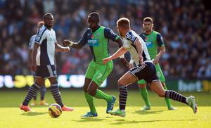Newcastle United's Moussa Sissoko is challenged by West Bromwich Albion's James Morrison during the Barclays Premier League match at the Hawthorns, West Bromwich. David Davies/PA Wire.