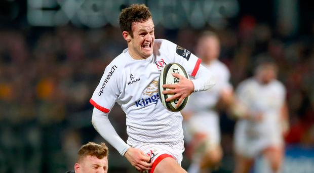 Top gear: Ulster's Billy Burns breezes past Peter Robb to score his side's second try