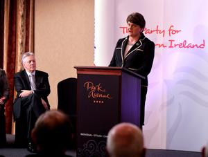 BELFAST, NORTHERN IRELAND - DECEMBER 17:  The new DUP leader Arlene Foster (R) addresses the media and party colleagues watched by Peter Robinson at the Park Avenue hotel after the Democratic Unionist Party electoral college meeting on December 17, 2015 in Belfast, Northern Ireland. Arlene Foster succeeds Peter Robinson and becomes the first female leader of the Democratic Unionist Party. No other nominations were put forward for the role of leader. Mrs Foster will also be appointed as the new Northern Ireland first minister in the coming weeks. The former Ulster Unionist Party member has enjoyed a rapid rise through the ranks of the DUP following her defection in 2004, twice standing in as temporary first minister for Peter Robinson in times of personal and political crisis. The DUP remain the largest political party within the provinces' Executive government.  (Photo by Charles McQuillan/Getty Images)