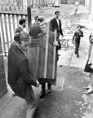 Riots: Belfast. Refugees. Furniture is carried into the schools meals centre in Butler Street as Roman Catholic families move from their homes in the Protestant area of the Crumlin Road.   5/8/1969