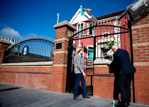 Constituency staff of Belfast West MLA Alex Maskey placing a message from Gerry Adams to the gates of Connolly House, Andersonstown, Belfast, after the death of Northern Ireland's former deputy first minister and ex-IRA commander Martin McGuinness aged 66. Liam McBurney/PA Wire