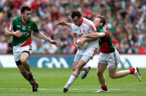 Mayo's Kevin McLoughlin and Colm Boyle with Cathal McCarron of Tyrone