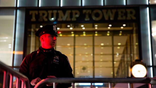 A police officer stands outside Trump Tower in New York City on election day November 8, 2016. / AFP PHOTO / DOMINICK REUTERDOMINICK REUTER/AFP/Getty Images