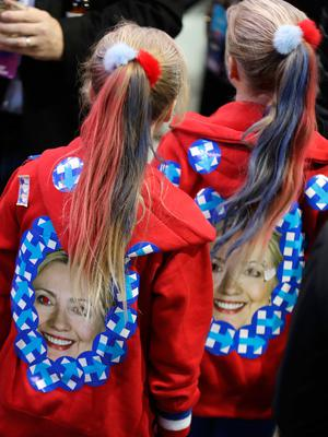 Girls wear jackets with the image of Hillary Clinton during Democratic presidential nominee's election night rally in the Jacob Javits Center glass enclosed lobby in New York, Tuesday, Nov. 8, 2016. (AP Photo/David Goldman)