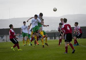Donegal Youths centre backs Stephen Black and Matthew McLaughlin rise high to direct this corner on goal against Carniney Youths at Leafair Park, Derry in Thursday's Hughes Insurance Foyle Cup. FC04-M2-05