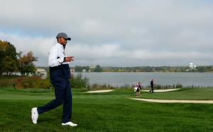 CHASKA, MN - SEPTEMBER 30:  Vice-captain Tiger Woods of the United States gives a thumbs up as he walks during morning foursome matches of the 2016 Ryder Cup at Hazeltine National Golf Club on September 30, 2016 in Chaska, Minnesota.  (Photo by Streeter Lecka/Getty Images)