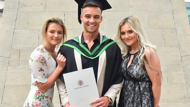 Graduating from Ulster University today is Owen McKee, with a degree in Computer Science. Donagh is pictured with Jordanne and Briana McKee. Photo by Simon Graham Photography