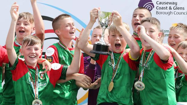 Winning feeling: Glentoran captain Lucas Miskimmin lifts the trophy after his side defeated Dungannon United Youth in the Minor final on the closing day of this year's STATSports SuperCupNI at Coleraine Showgrounds yesterday
