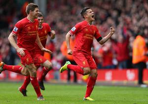 Philippe Coutinho of Liverpool celebrates scoring his team's third goal during the Barclays Premier League match between Liverpool and Manchester City at Anfield on April 13, 2014 in Liverpool, England.  (Photo by Alex Livesey/Getty Images)