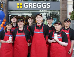 Greggs, which has 11 stores in Northern Ireland, has bolstered sales despite seeing profits take a hit from costs linked to restructuring the business.