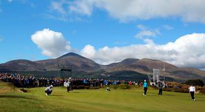 Irish golfer Padraig Harrington (L) lines up up tee shot on the 17th green, in front of the Mournes mountains, on the second day of the Irish Open at the Royal County Down Golf Club in Newcastle in Northern Ireland on May 29, 2015.      AFP PHOTO / PAUL FAITHPAUL FAITH/AFP/Getty Images
