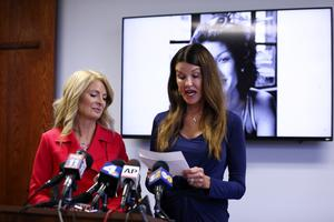 Model Janice Dickinson, right, speaks at a press conference, announcing a settlement of her defamation lawsuit against comedian Bill Cosby (Katherine Campione/AP)
