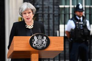 LONDON, ENGLAND - JUNE 04:  Britain's Prime Minister Theresa May addresses the media as she makes a statement, following a COBRA meeting in response to last night's London terror attack, at 10 Downing Street on June 4, 2017 in London, England.  (Photo by Leon Neal/Getty Images)