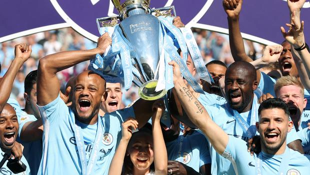 Manchester City players celebrate winning the Premier League title