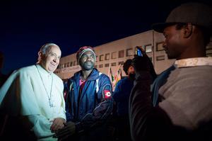 Pope Francis meets migrants  during his visit at the Castelnuovo di Porto refugees center near Rome on March 24, 2016.