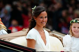 This file photo taken on April 29, 2011 shows Philippa (Pippa) Middleton smiling as she travels after the wedding service for Britain's Prince William and Kate, Duchess of Cambridge