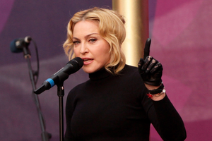 """Madonna, said that she """"couldn't help myself"""" when she flashed her bottom at the Grammys."""