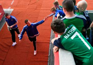 BELFAST, NORTHERN IRELAND - MAY 27: Northern Ireland's Paddy McNair high-fives some fans before the international friendly game between Northern Ireland and Belarus on May 26, 2016 in Belfast, Northern Ireland. (Photo by Charles McQuillan/Getty Images)