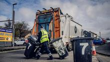 Belfast City Council workers collect black bins in Brown Square, north Belfast during the coronavirus pandemic in Northern Ireland on Friday, March 27th 2020 (Photo by Kevin Scott for Belfast Telegraph)