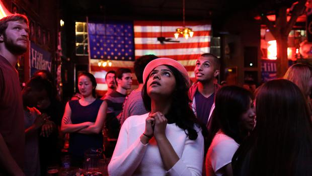 Sri Vasamsetti, 22, of Seattle and a supporter of Democratic presidential candidate Hillary Clinton, watches televised coverage of the US presidential election at the Comet Tavern in the Capitol Hill neighborhood of Seattle, Washington on November 8, 2016.  / AFP PHOTO / Jason RedmondJASON REDMOND/AFP/Getty Images