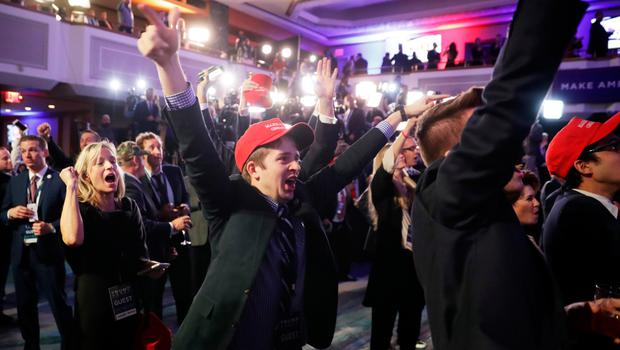 NEW YORK, NY - NOVEMBER 08: People cheer as voting results for Florida come in at Republican presidential nominee Donald Trumps election night event at the New York Hilton Midtown on November 8, 2016 in New York City. Americans today will choose between Republican presidential nominee Donald Trump and Democratic presidential nominee Hillary Clinton as they go to the polls to vote for the next president of the United States.  (Photo by Chip Somodevilla/Getty Images)