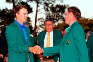AUGUSTA, GEORGIA - APRIL 10:  Jordan Spieth of the United States shakes hands with Danny Willett of England after presenting him with the green jacket for winning the final round of the 2016 Masters Tournament at Augusta National Golf Club on April 10, 2016 in Augusta, Georgia.  (Photo by Kevin C. Cox/Getty Images)