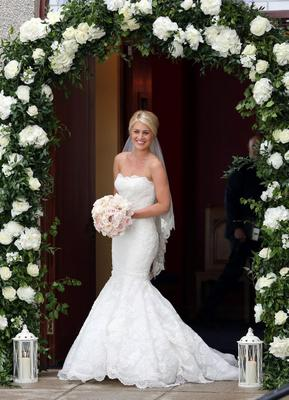 Bride Helen McConnell arrives for her wedding to Manchester United footballer Jonny Evans as at Clough Presbyterian Church, County Down. PRESS ASSOCIATION Photo. Picture date: Saturday June 1, 2013. See PA story SOCIAL Evans. Photo credit should read: Paul Faith/PA Wire