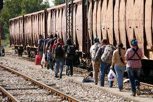 "This handout photograph taken and released by Caritas Internationalis on September 5, 2015 in Gevgelija, shows migrants making their way to board a train for Serbia, at the border between Greece and Macedonia. More than 230,000 refugees and migrants have arrived in Greece by sea this year, a huge rise from 17,500 in the same period in 2014, shipping ministry said on September 3. AFP PHOTO / CARITAS INTERNATIONALIS / MATTHIEU ALEXANDRE  -- EDITORS NOTE -- RESTRICTED TO EDITORIAL USE - MANDATORY CREDIT ""AFP PHOTO/ MATTHIEU ALEXANDRE/CARITAS INTERNATIONALIS"" - NO MARKETING NO ADVERTISING CAMPAIGNS ----CAR04MATTHIEU ALEXANDRE/AFP/Getty Images"
