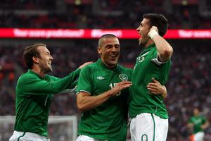Republic of Ireland's Shane Long (right) celebrates scoring the opening goal of the game during the International Friendly match at Wembley Stadium, London. PRESS ASSOCIATION Photo. Picture date: Wednesday May 29, 2013. See PA story SOCCER England. Photo credit should read: John Walton/PA Wire. RESTRICTIONS: Use subject to FA restrictions. Editorial use only. Commercial use only with prior written consent of the FA. No editing except cropping. Call +44 (0)1158 447447 or see www.paphotos.com/info/ for full restrictions and further information.