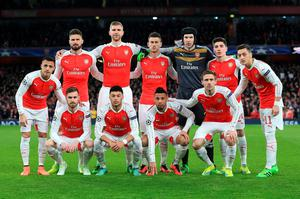Arsenal's (Top row left-right)Alexis Sanchez, Olivier Giroud, Per Mertesacker, Laurent Koscielny, Petr Cech, Hector Bellerin, Mesut Ozil (Bottom row left-right) Aaron Ramsey, Alex Oxlade-Chamberlain, Francis Coquelin, and Nacho Monreal pose for a team photo during the UEFA Champions League match at the Emirates Stadium, London. PRESS ASSOCIATION Photo. Picture date: Tuesday February 23, 2016. See PA story SOCCER Arsenal. Photo credit should read: Adam Davy/PA Wire