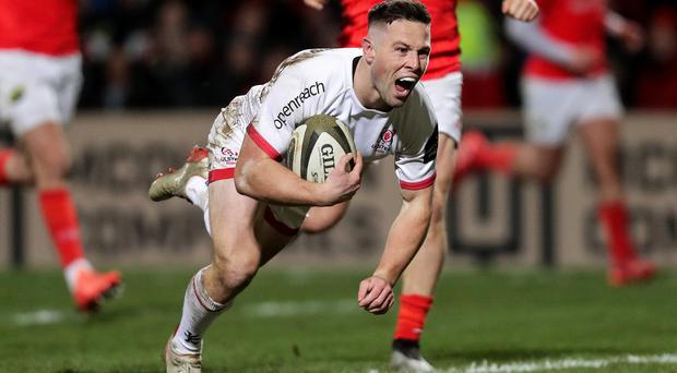 Ulster's John Cooney goes over for his try against Munster on Friday night (INPHO/Laszlo Geczo)