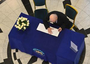 Pacemaker Press Belfast 23-05-2017:  Belfast City Council Councillor Billy Hutchinson pictured signing a Book of Condolences, that was opened up for the victims of last night's bomb attack in Manchester, at  Belfast City Hall. Picture By: Arthur Allison.