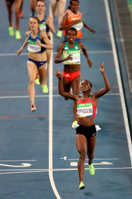 RIO DE JANEIRO, BRAZIL - AUGUST 16:  Faith Chepngetich Kipyegon of Kenya celebrates winning the gold medal in the Women's 1500m Final on Day 11 of the Rio 2016 Olympic Games at the Olympic Stadium on August 16, 2016 in Rio de Janeiro, Brazil.  (Photo by Alexander Hassenstein/Getty Images) *** BESTPIX ***