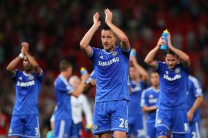MANCHESTER, ENGLAND - AUGUST 26:  John Terry of Chelsea and his team-mates applaud the fans at the end of the Barclays Premier League match between Manchester United and Chelsea at Old Trafford on August 26, 2013 in Manchester, England.  (Photo by Alex Livesey/Getty Images)