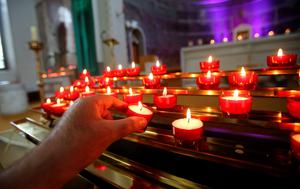 Candles are lit in memory of the victims of the Berkeley balcony collapse at Our Lady of Perpetual Succour church in Foxrock, Dublin. Photo: Niall Carson/PA