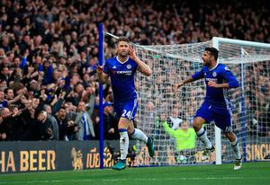 "Chelsea's Gary Cahill celebrates scoring his side's second goal of the game during the Premier League match at Stamford Bridge, London. PRESS ASSOCIATION Photo. Picture date: Sunday October 23, 2016. See PA story SOCCER Chelsea. Photo credit should read: John Walton/PA Wire. RESTRICTIONS: EDITORIAL USE ONLY No use with unauthorised audio, video, data, fixture lists, club/league logos or ""live"" services. Online in-match use limited to 75 images, no video emulation. No use in betting, games or single club/league/player publications."