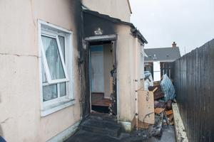 The damaged caused to the door at the Stokes' family home in Drumard Park in the Hazelbank area of Derry. Picture Martin McKeown. Inpresspics.com.