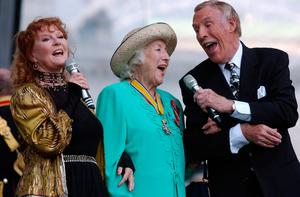 """Sir Bruce Forsyth with Dame Vera Lynn (centre) and Petula Clark (left) as they sing a rendition of """"We'll Meet Again"""" during a show. Edmond Terakopian/PA Wire"""
