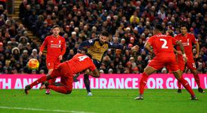 LIVERPOOL, ENGLAND - JANUARY 13: Olivier Giroud (C) of Arsenal scores his team's third goal during the Barclays Premier League match between Liverpool and Arsenal at Anfield on January 13, 2016 in Liverpool, England.  (Photo by Alex Livesey/Getty Images)