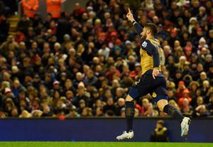 Arsenal's French striker Olivier Giroud celebrates after scoring during the English Premier League football match between Liverpool and Arsenal at Anfield stadium in Liverpool, north-west England on January 13, 2016. AFP PHOTO / PAUL ELLIS RESTRICTED TO EDITORIAL USE. NO USE WITH UNAUTHORIZED AUDIO, VIDEO, DATA, FIXTURE LISTS, CLUB/LEAGUE LOGOS OR 'LIVE' SERVICES. ONLINE IN-MATCH USE LIMITED TO 75 IMAGES, NO VIDEO EMULATION. NO USE IN BETTING, GAMES OR SINGLE CLUB/LEAGUE/PLAYER PUBLICATIONS.PAUL ELLIS/AFP/Getty Images