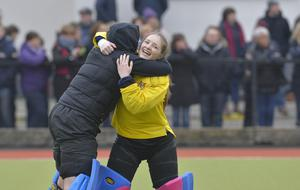 Mandatory Credit: Rowland White / PressEye Belfast Telegraph Schools' Cup Semi-Final Teams: Banbridge Academy (red) v Ballyclare High School (blue) Venue: Lisnagarvey Date: 11th February 2015 Caption: Sarah McCabe is congratulated by reserve goalkeeper Naomi Matthews