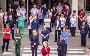 Health care staff hold a minute's silence at the Nightingale Hospital in south Belfast for key workers who have died as a result of Covid-19. (Photo by Kevin Scott for Belfast Telegraph)
