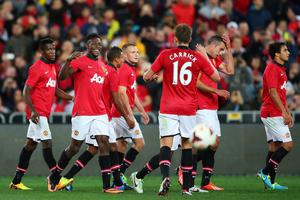 SYDNEY, AUSTRALIA - JULY 20:  Danny Welbeck of Manchester United celebrates with team mates after scoring his second goal during the match between the A-League All-Stars and Manchester United at ANZ Stadium on July 20, 2013 in Sydney, Australia.  (Photo by Brendon Thorne/Getty Images)