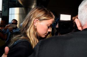 GOLD COAST, AUSTRALIA - APRIL 18:  Amber Heard arrives at Southport Magistrates Court on April 18, 2016 in Gold Coast, Australia. Heard is facing two counts of breaching Australia's quarantine laws by allegedly bringing in her pet dogs Pistol and Boo on a private jet in May 2015.  (Photo by Matt Roberts/Getty Images)