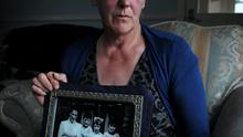 Helen McKendry holding a picture of murdered mum Jean McConville