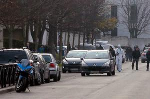 """A forensic expert is seen outside Jean-Perrin nursery school in Aubervilliers, a suburb northeast of Paris, where a teacher was attacked in the morning by a man wielding a box cutter and scissors who cited the Islamic State (IS) jihadist group, sources in the police and prosecutor's office said. The 45-year-old teacher was stabbed in the side and throat while preparing for his class at the school, but his life was not in danger, a police source said. The assault comes after the Islamic State in November urged its followers to kill teachers in the French education system for teaching secularism and being """"in open war against the Muslim family"""". / AFP / JACQUES DEMARTHONJACQUES DEMARTHON/AFP/Getty Images"""