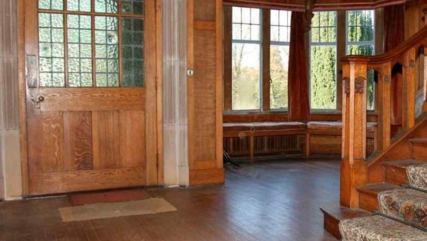 The Demesne House's wood panelled entrance hall