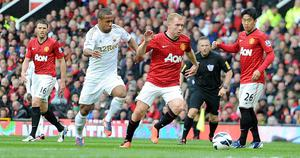 Swansea City's Wayne Routledge and Manchester United's Paul Scholes (centre right) battle for the ball during the Barclays Premier League match at Old Trafford, Manchester. PRESS ASSOCIATION Photo. Picture date Sunday May 12, 2013. See PA story SOCCER Man Utd. Photo credit should read: Martin Rickett/PA Wire. RESTRICTIONS: Editorial use only. Maximum 45 images during a match. No video emulation or promotion as 'live'. No use in games, competitions, merchandise, betting or single club/player services. No use with unofficial audio, video, data, fixtures or club/league logos.